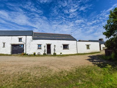 Photo for Located on a traditional family farm, this Pembrokeshire cottage is ideally located for that tranqui