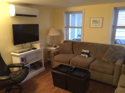 Flat screen TV, DVD player, and plenty of room to relax in the living room.