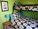 Twin on top, double on bottom. New paint and linens. Small dresser.