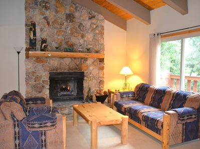 Living Room with Large Woodburning Stone Fireplace