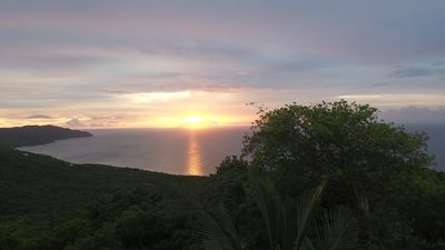 Photo for Beautiful mountain top cottage with a gorgeous view of the Caribbean Sea