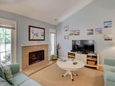 Photo for Homey condo w/ shared pool, patio, modern kitchen & more - walk to beach!
