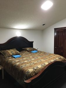 Master bedroom-king size bed. New carpet. TV. Bathroom -stand up shower. Balcony