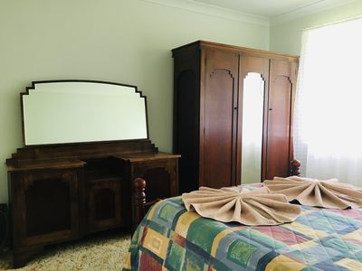 Bedroom one with antique Chinese style solid wood furniture
