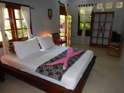 Queen sized Teak bed - has TV with int'l channels
