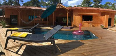 Photo for La Pignotte. New wooden house with swimming pool in Maubuisson (Carcans), Gironde,