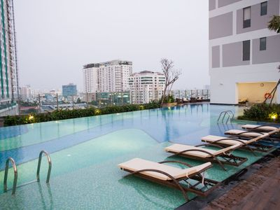 Photo for Free Infinity Pool+Gym Towntown Apartment near Benthanh Market