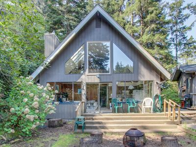 Photo for Lovely dog-friendly home w/ lakefront views, dock, and a private guest cottage!