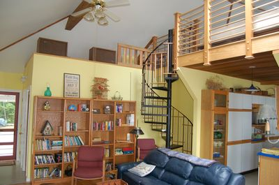 The spiral staircase ascends to sleeping loft