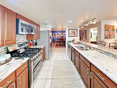 Kitchen - The spacious kitchen has a stainless steel gas range and side-by-side fridge for effortless meal prep.