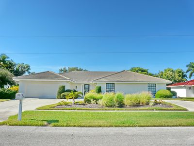 Photo for Tranquil home on golf course w/ hot tub & spacious heated pool