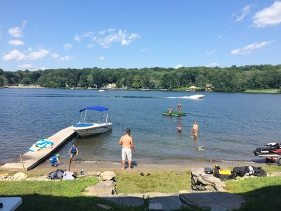 Located on Coventry Lake. Walk out the back door and you are in the lake!