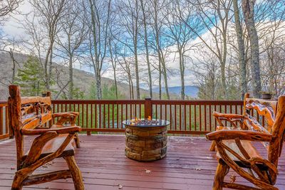 Enjoy Mountain Views from Custom Crafted Live Edge Benches flanking Fire Table Rear Deck at The Pointe