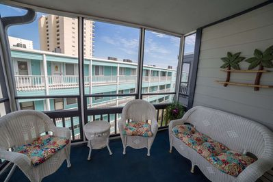 Nicely furnished balcony for enjoying the ocean air.  Beach view is limited.