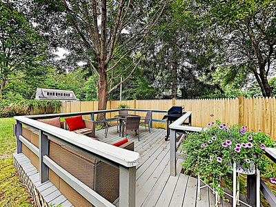 Backyard - Grill dinner on the private backyard deck, complete with a gas BBQ, patio table, and cushioned sofa.