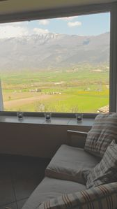 View  from the lounge across the valley with vineyards below.