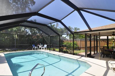 Large screened pool and patio. 6 ' high privacy fence.