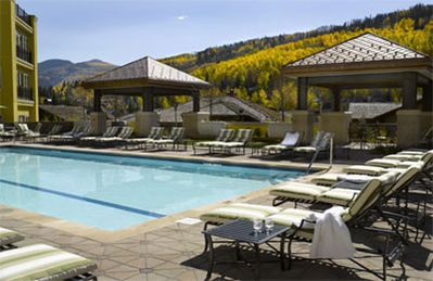 Splash around in one of Vail's nicest and spacious pools with stunning views.