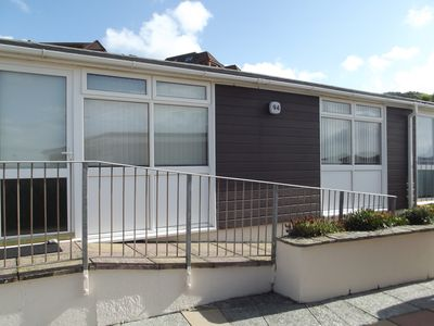 Photo for Spacious 3 bedroom chalet 100 yards from the sea ideal for families.