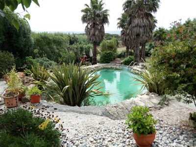 Photo for Self contained apartment with pool, minutes from the beach