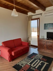 Photo for Panoramic penthouse in the center of Quartu S. Elena a few minutes from the sea. IUN P1349