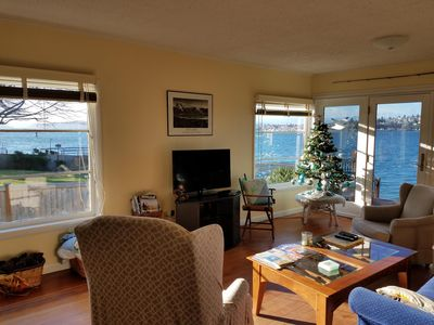 Cheerful living room with natural light and incredible view of Sinclair Inlet.