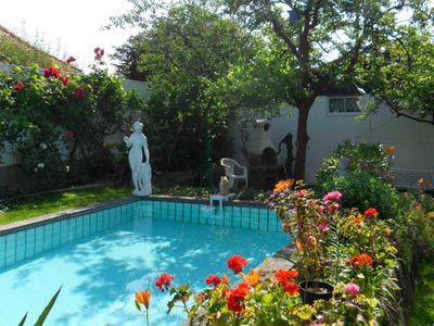 Photo for Bungalow in the flowered garden with pool