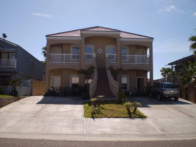 #2 bottom left unit new hot tub and now heated pool 125 steps to the beach
