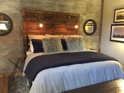 The Headboard is built with reclaimed wood, edison bulb lamps and usb port
