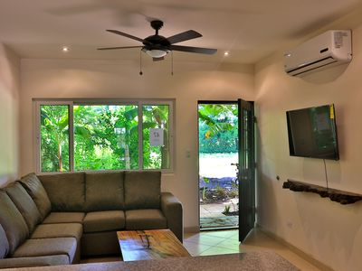 Photo for Brand New condo steps to the pool and minutes to the beach!