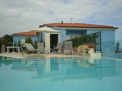 Photo for Bright and elegant villa with private pool and garden terrace with sea view