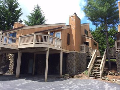Photo for Top of the mountain! Condo nestled in the woods.  Ski in-ski out