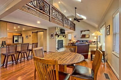 Open and airy living, with a mountain laurel railing and skylights!