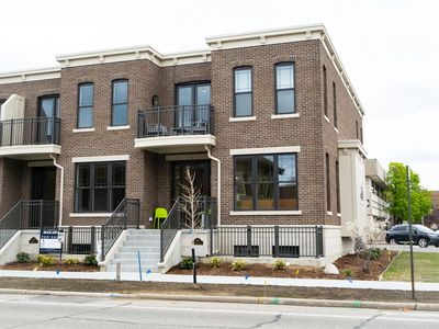 Photo for Affordable luxury in a brand new Row House Condo just steps from all things GH!