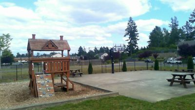 Community Playground with big toy and basketball court