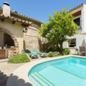 Photo for Picturesque Townhouse with Wi-Fi, Air Conditioning, Garden and Pool