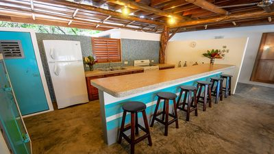 Kitchen with large bar, comfortable seating for 8 people.
