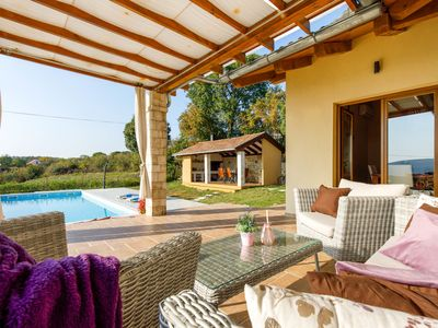 Photo for This 3-bedroom villa for up to 8 guests is located in Drniš/Drnis and has a private swimming pool, a