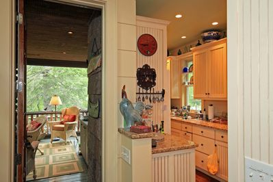 Kitchen and view to screen porch
