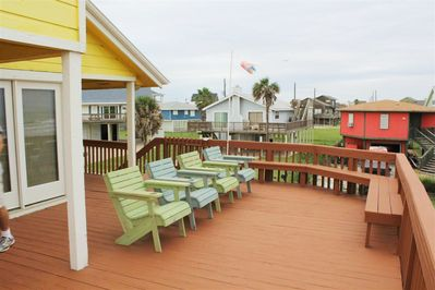 East view of the deck. There are more chairs located behind the photographer.