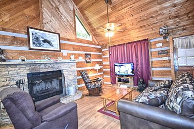 Open Living room w/TV Sofa Sleeper and Fireplace