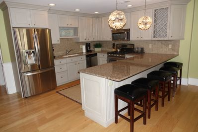 Designer kitchen with full size, French door style refrigerator