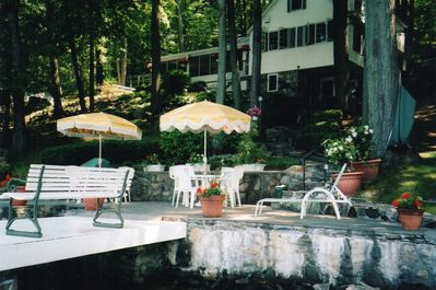 View of house and patio from lake. (Porch can be seen on left side of house.)