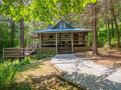 Photo for Rustic hand hewn log cabin with pet friendly accommodations close to Conkle's Hollow, Old Man's Cave