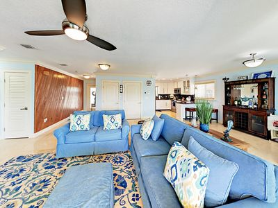 """Living Room - Settle into a coastal sofa and love seat set to watch a new film on the 60"""" surround sound TV."""