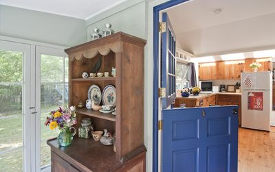 Enter the studio through the Dutch door from the screened-in blue stone porch