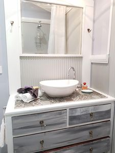 Shearer shed inspired shower room. Up cycled vanity.