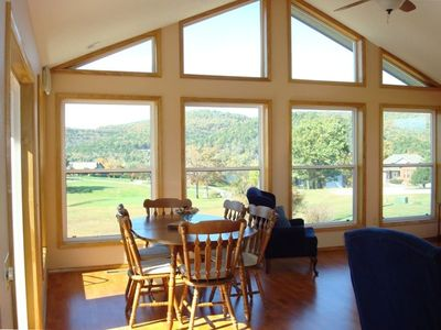 Newer Sun Room w/ HDTV  overlooks the golf course, bluffs, and Table Rock lake