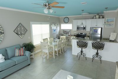 Open floor plan with beautifully painted ceilings that remind you of the beach!
