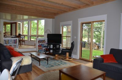 High-ceilinged, views to water, timber-frame construction